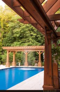 pergola-cascading-waterfall-into-pool